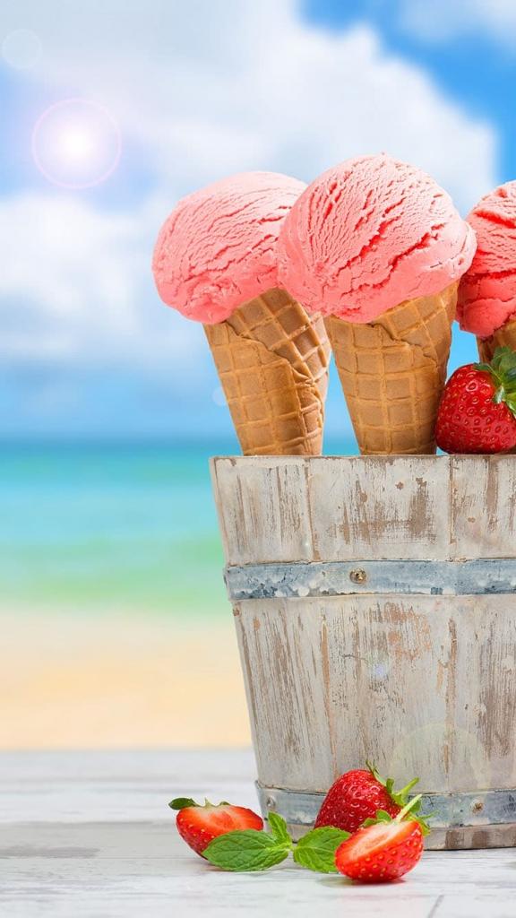 iPhone 7 achtergrond met met ijsjes in een houten emmer op het strand
